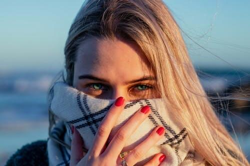 girl with scarf face covering